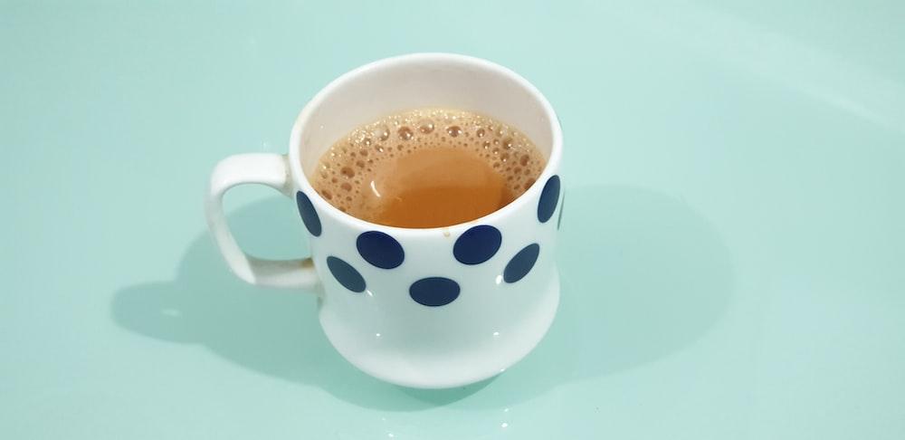 white and blue polka-dot ceramic mug