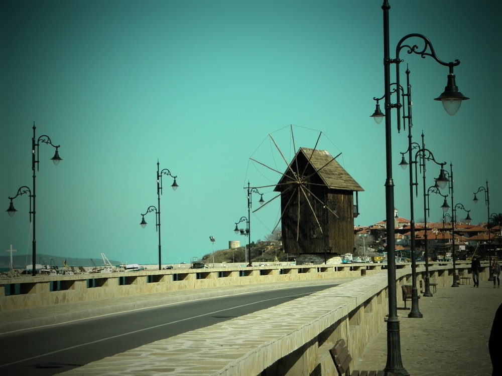 brown wooden windmill hut photo