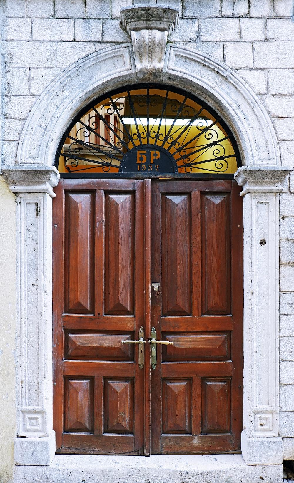 closed brown wooden door panels