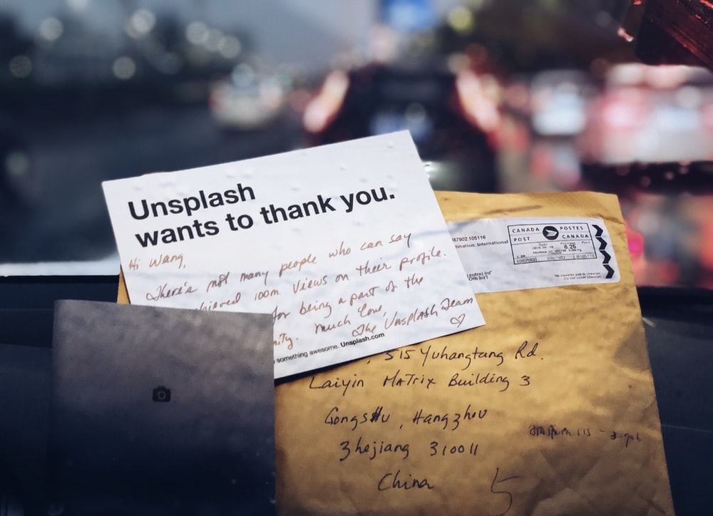 unplash wants to thank you signage