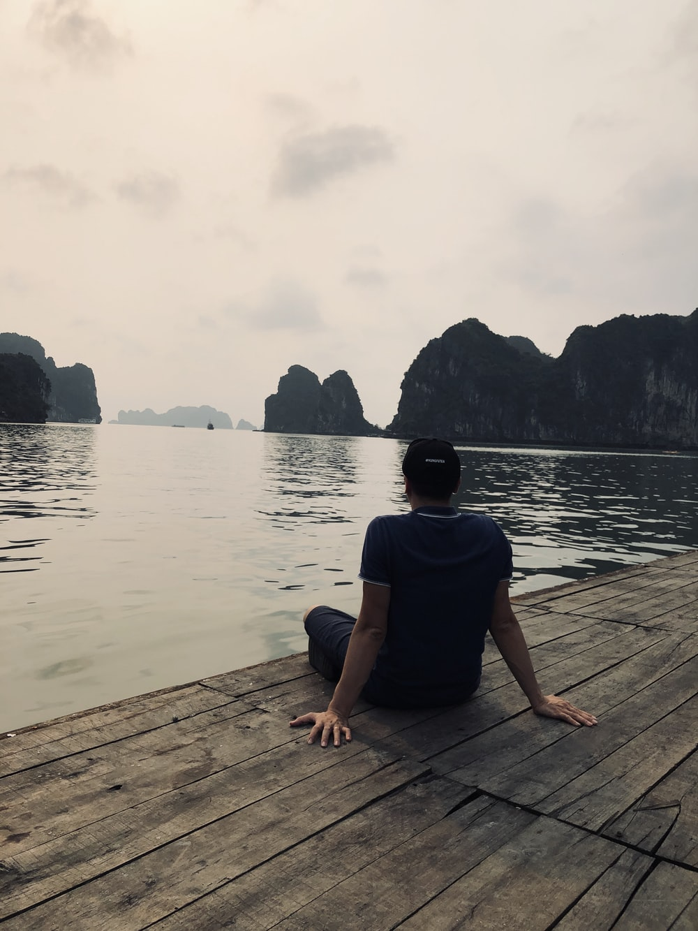 man sitting on duck
