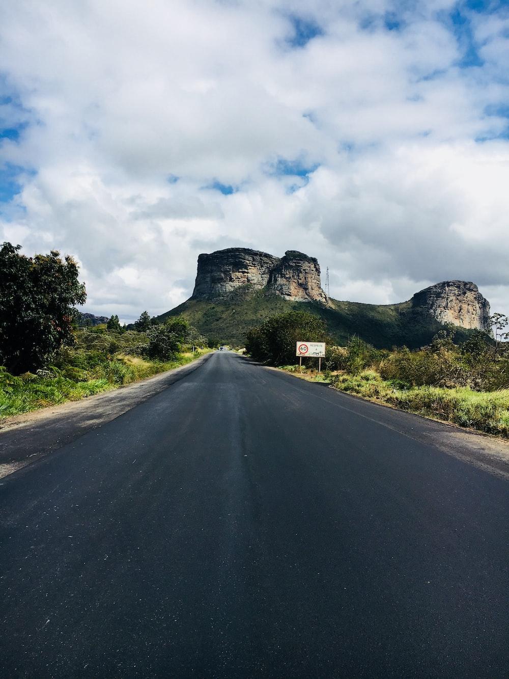 gray concrete road near mountain