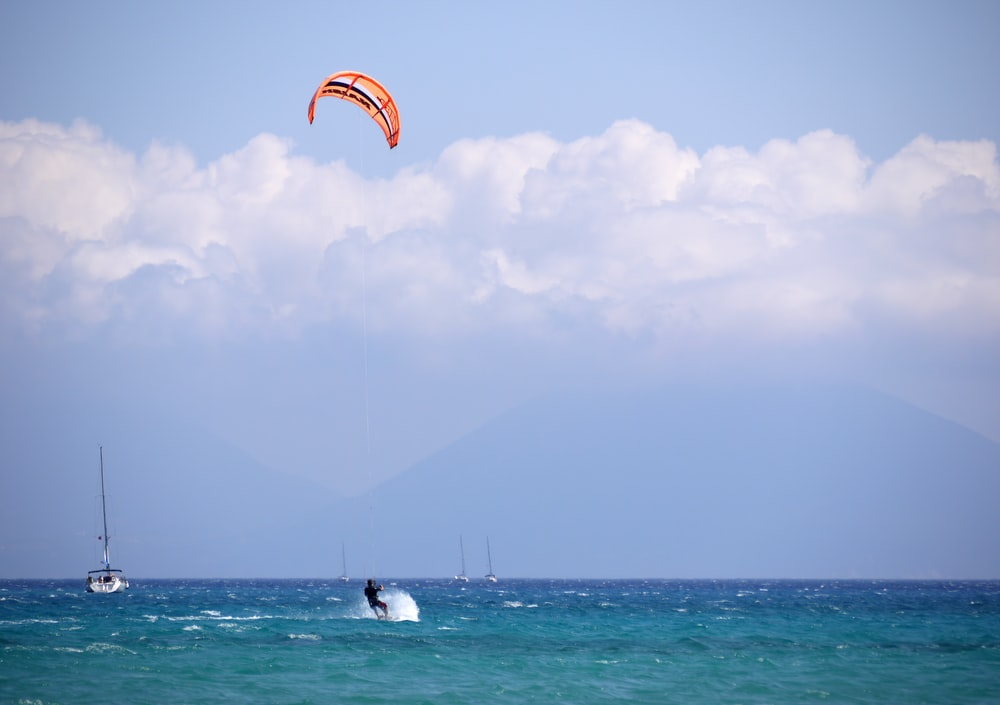 person parachute water skiing