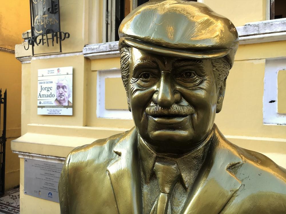 smiling man statue