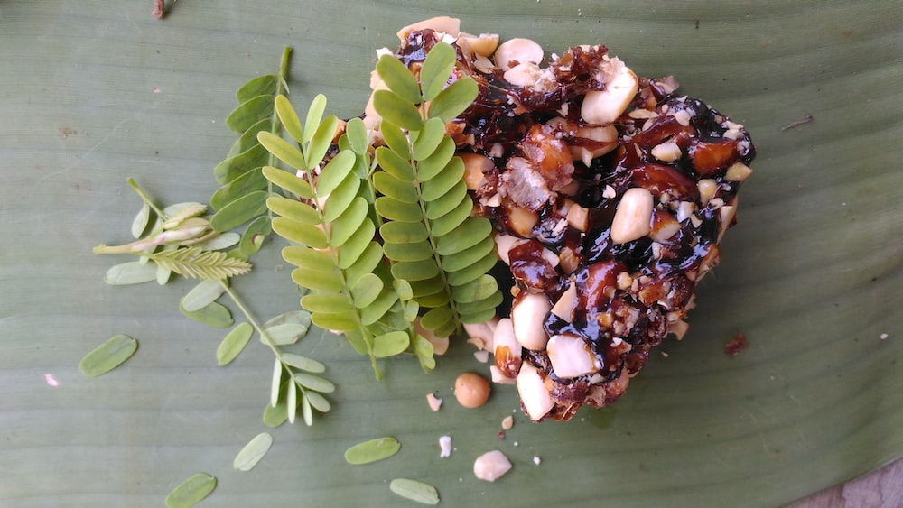 green leaves on nuts covered food