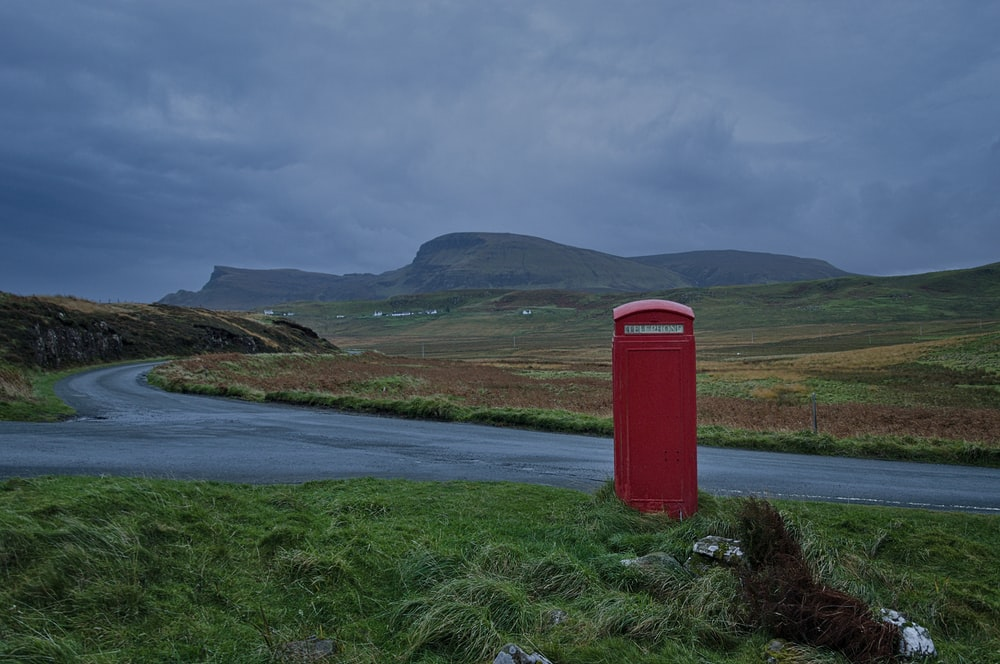 red telephone booth near road
