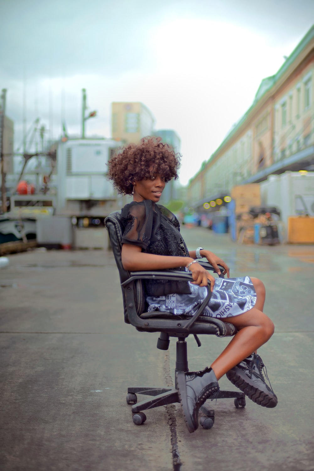 shallow focus photo of woman sitting on swivel chair
