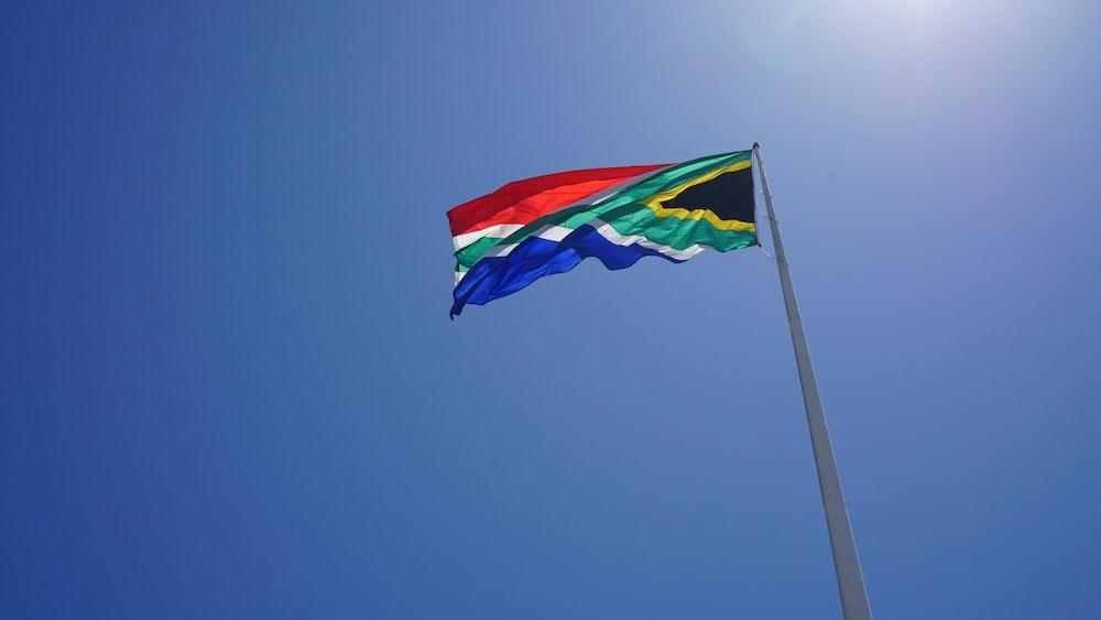flag on a pole under calm blue sky