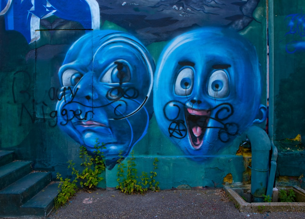 two blue balloons graffiti