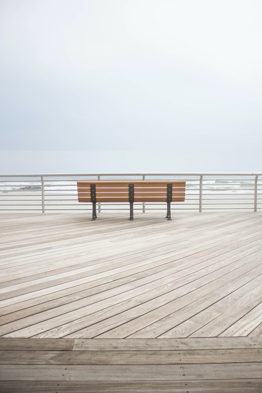brown wooden bench at the dock