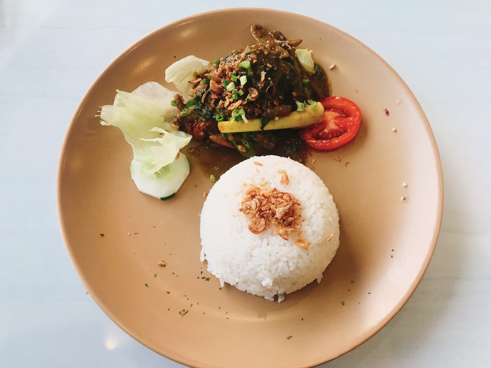 plate of rice and cooked food