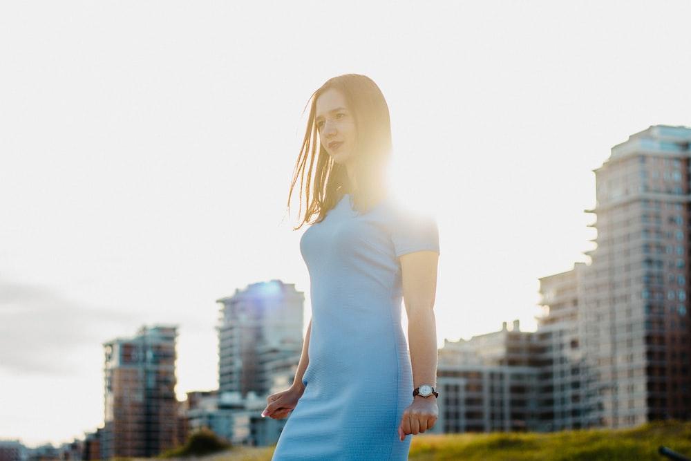 woman standing near building