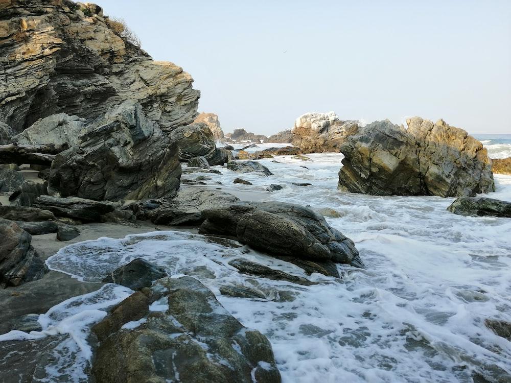 water waves on brown rocks