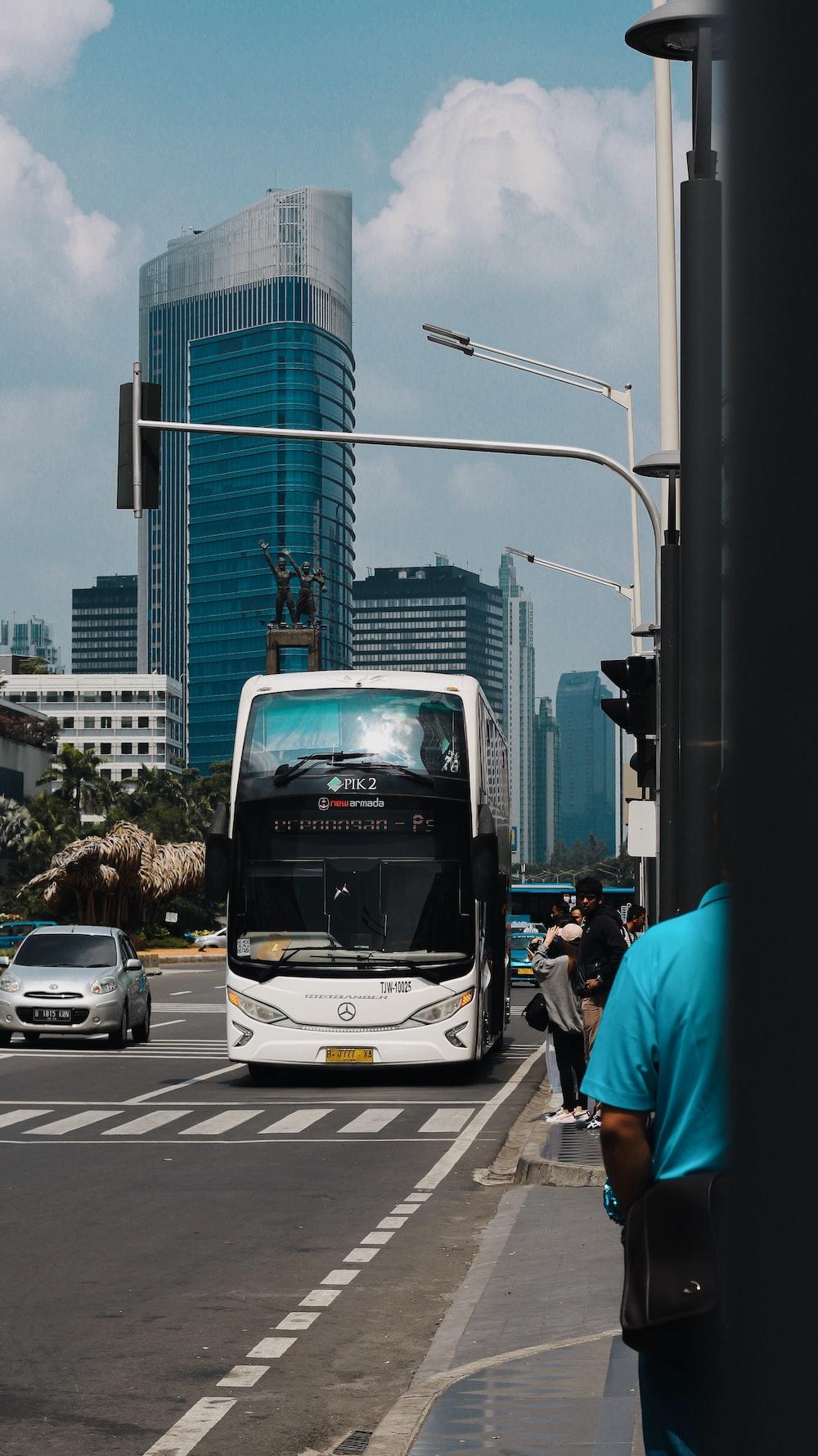 white bus running on road
