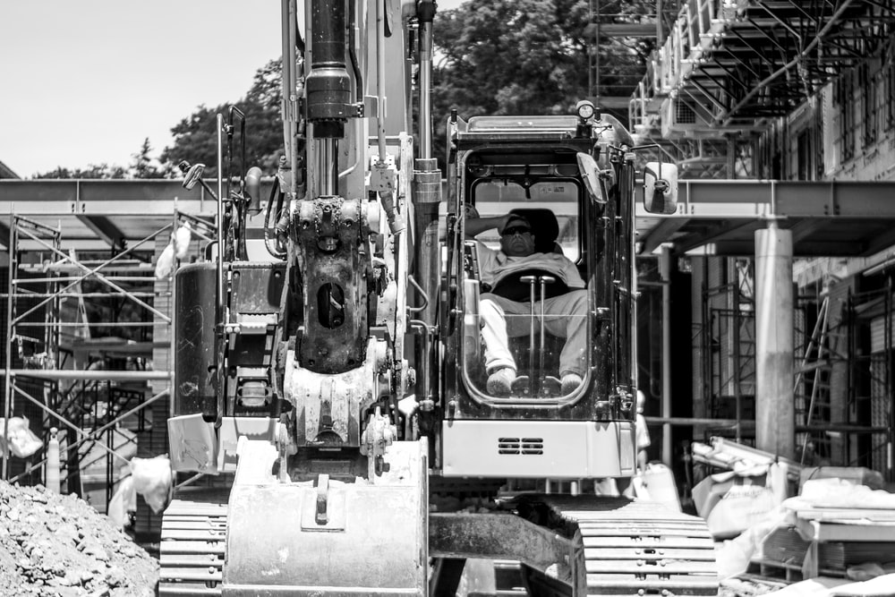 grayscale photo of heavy equipment