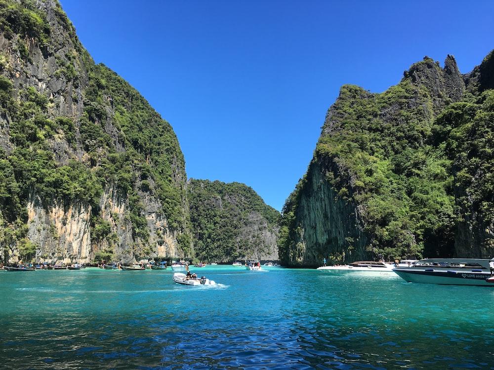 boat on water between rock formatios