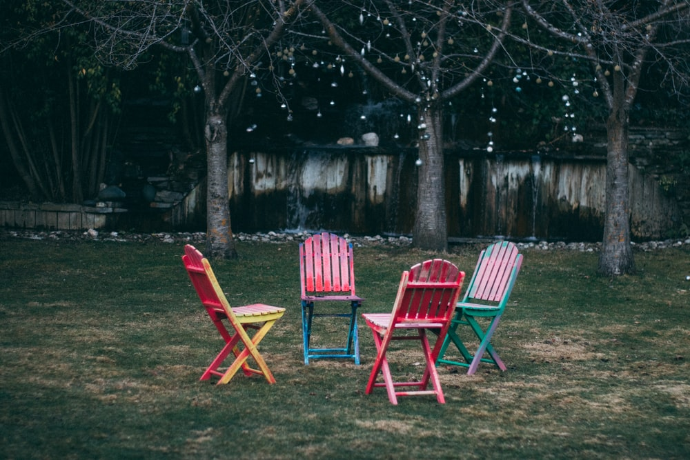 four assorted-color wooden chairs