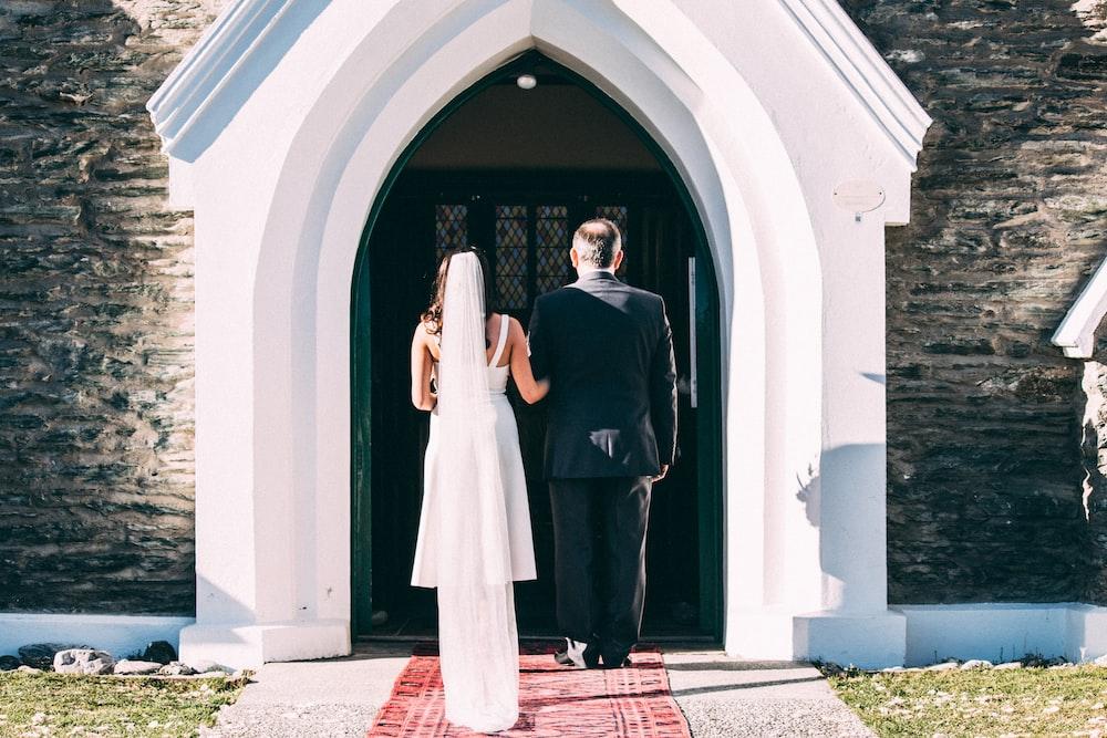 couple standing near closed door
