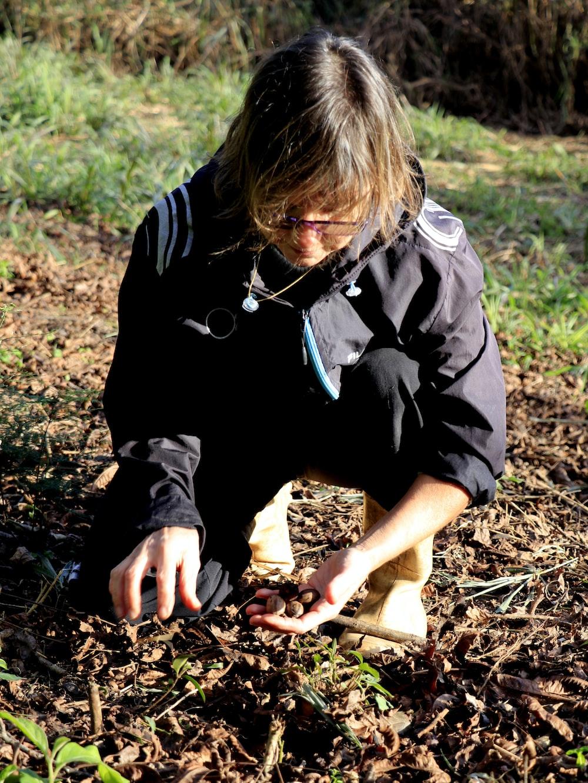 woman kneeling on ground