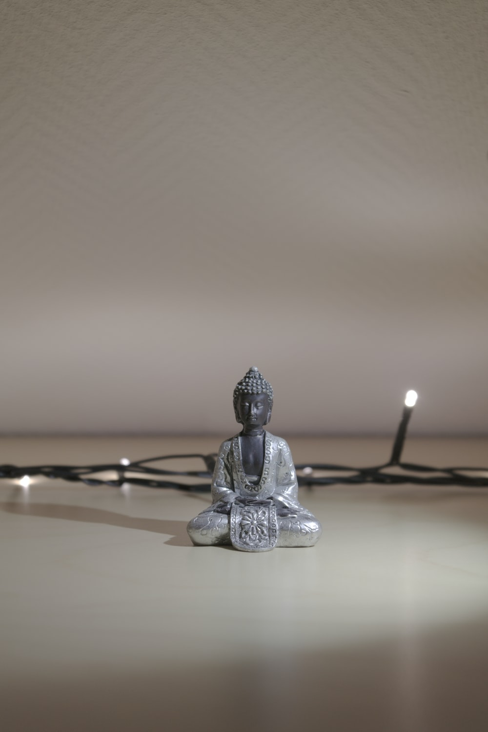 gray buddha figurine]