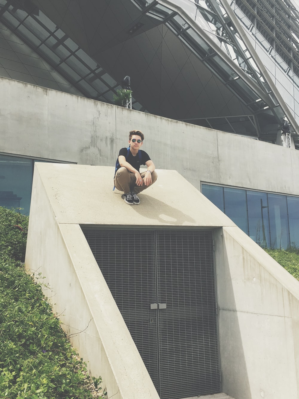 man siting on top of building entrance