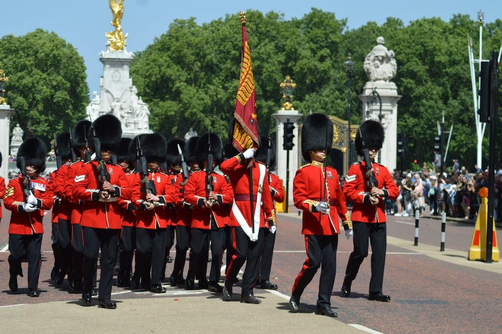 royal guards walking near people