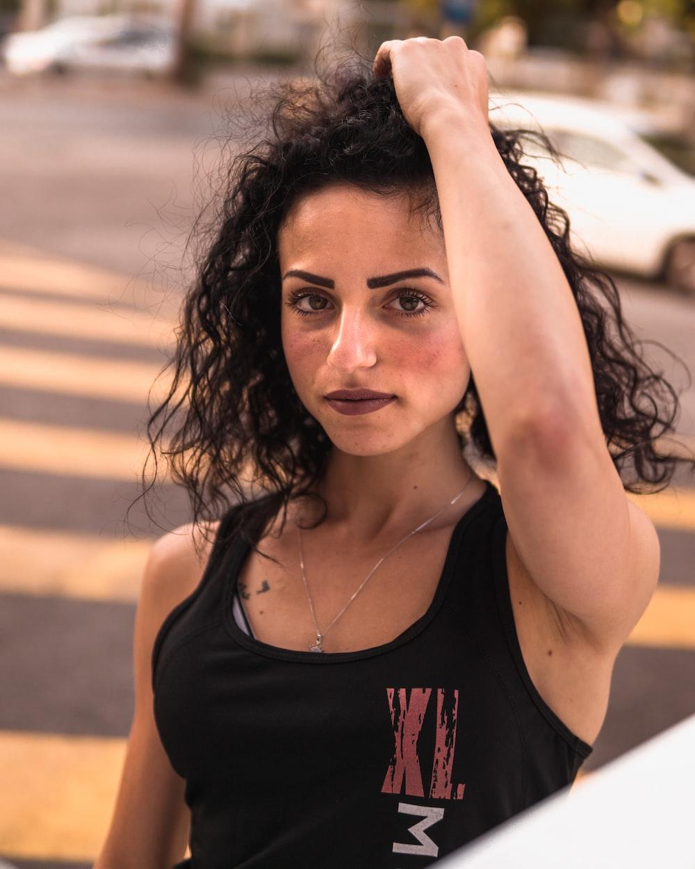 women wearing a black tank top close-up photography