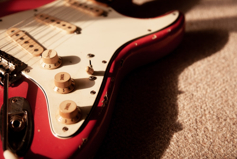 white and red electric guitar