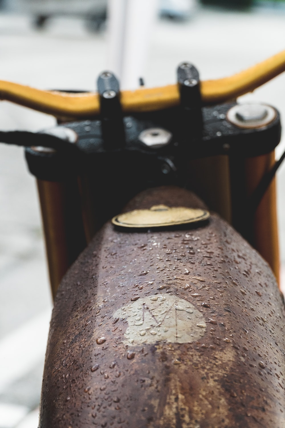 brown motorcycle on selective focus photography