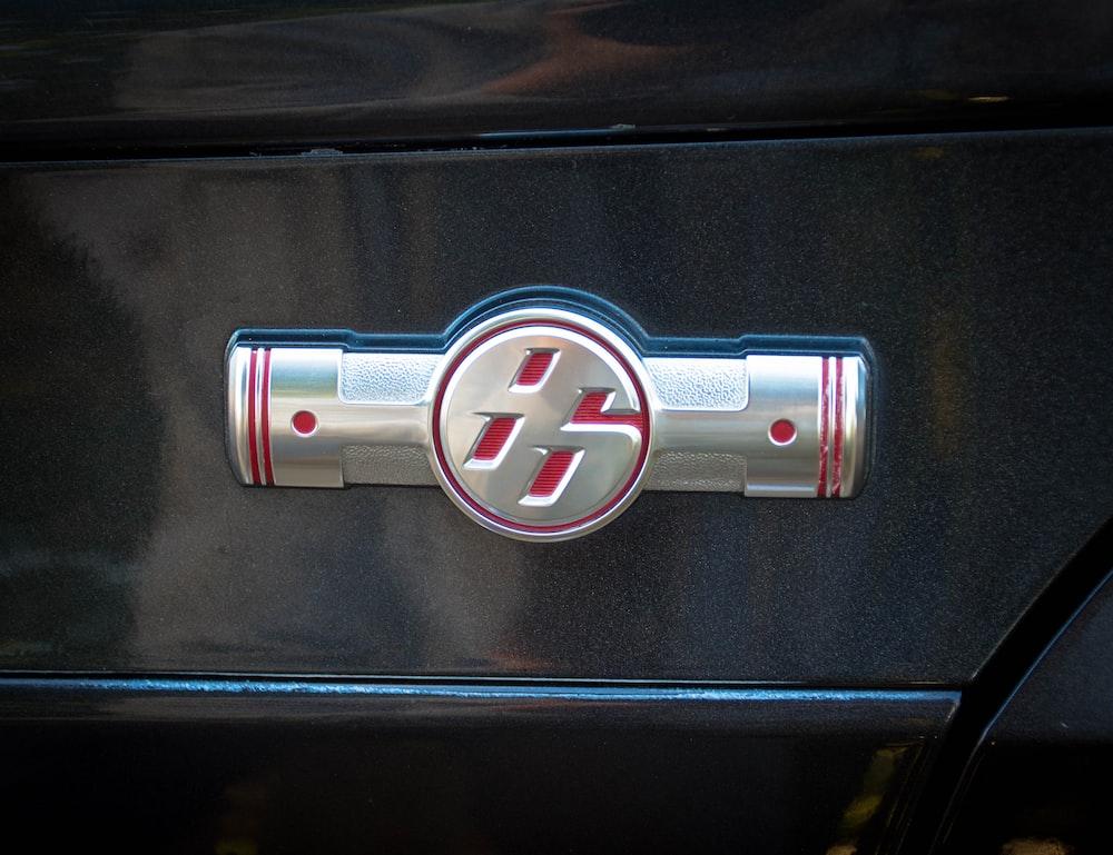 gray embossed emblem