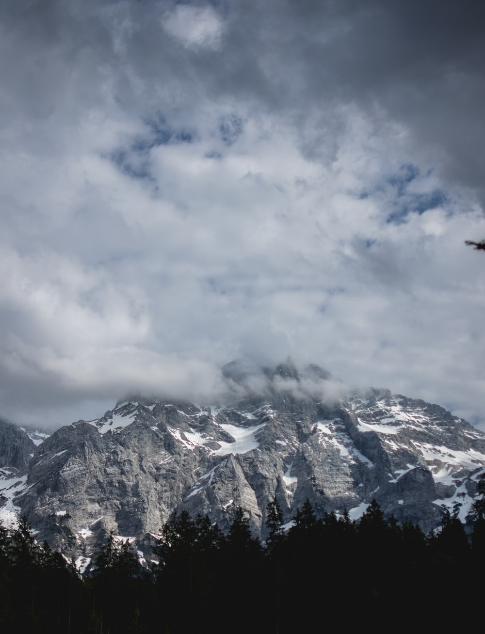 snow capped mountain under white clouds