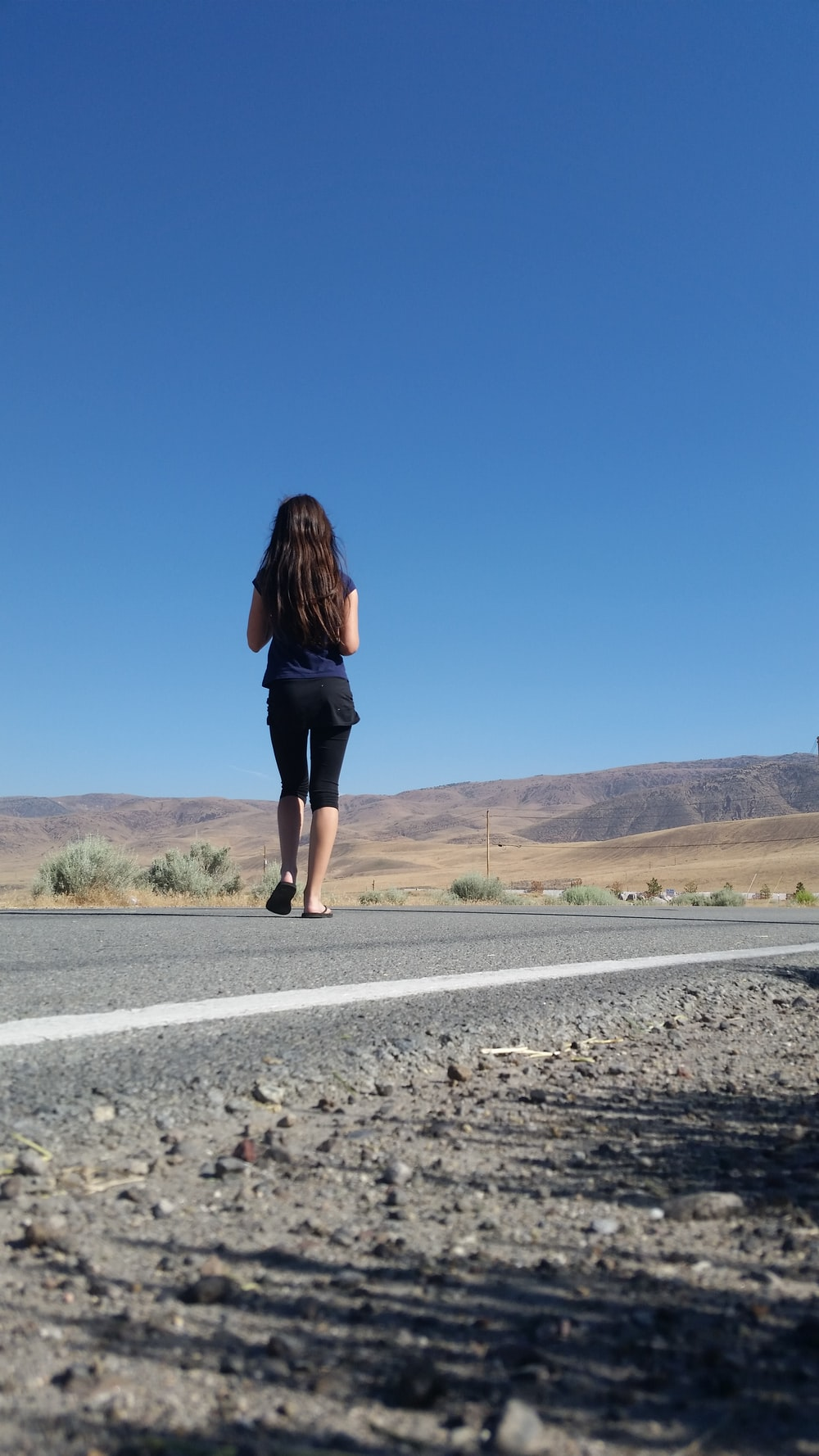 girl standing in road during daytime