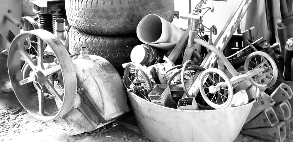 grayscale photo of trike near tires