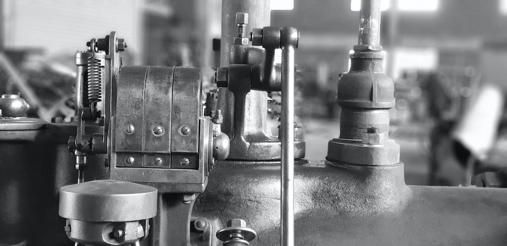 grayscale photograhy of machine