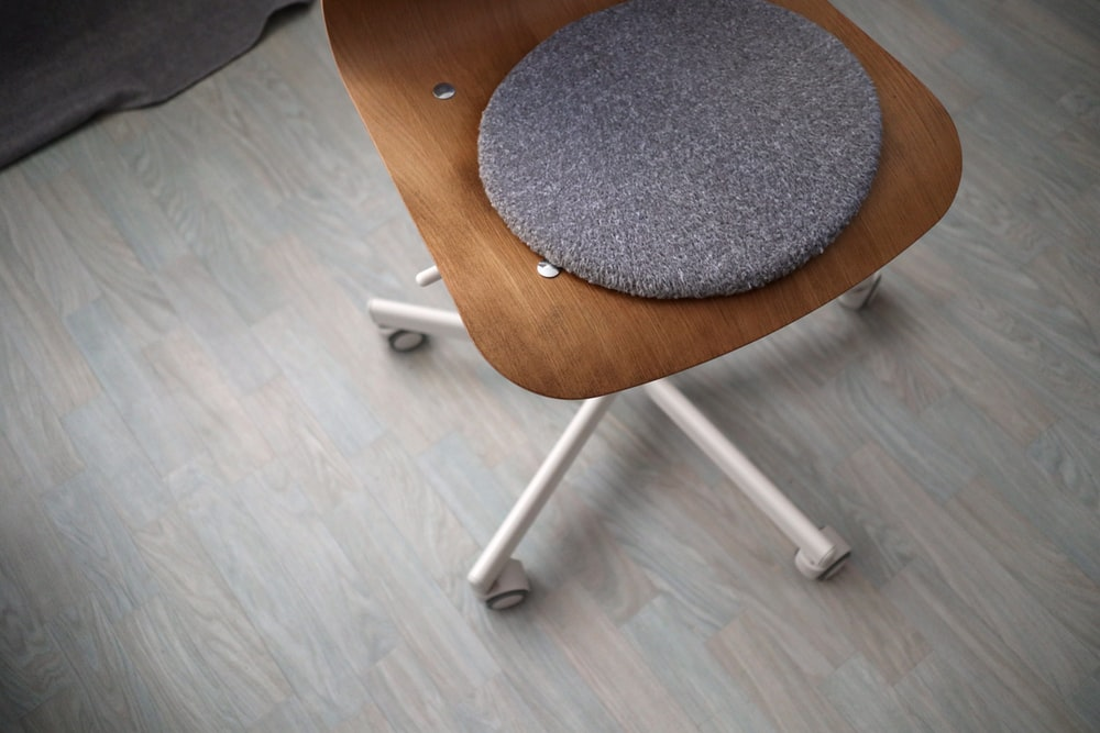 brown office rolling chair