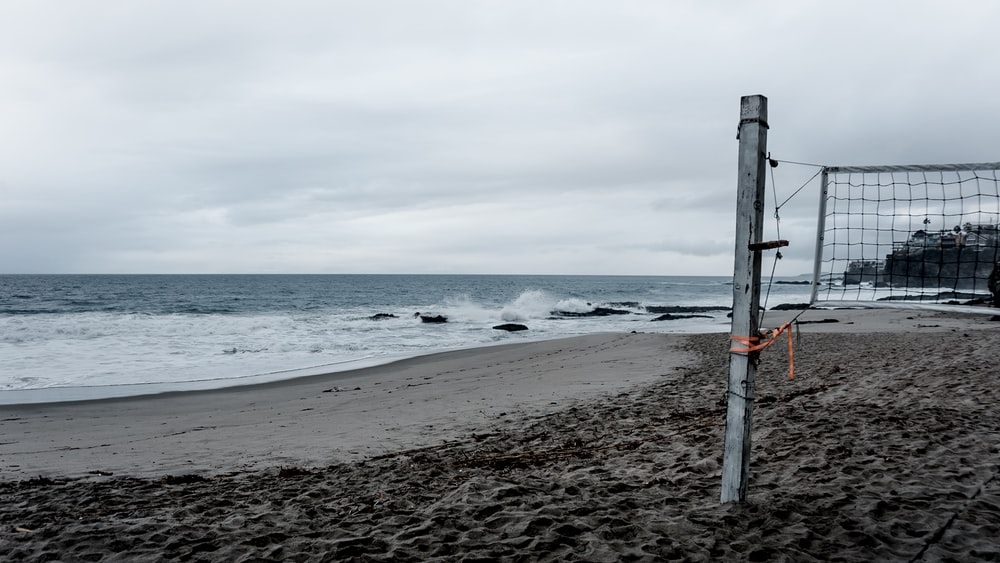 net on seashore at daytime