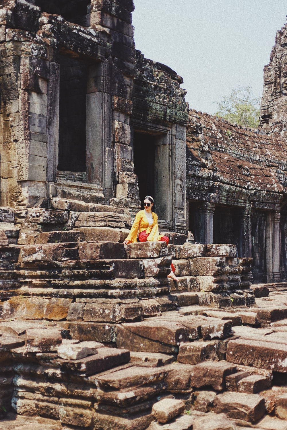 woman sitting on ruins