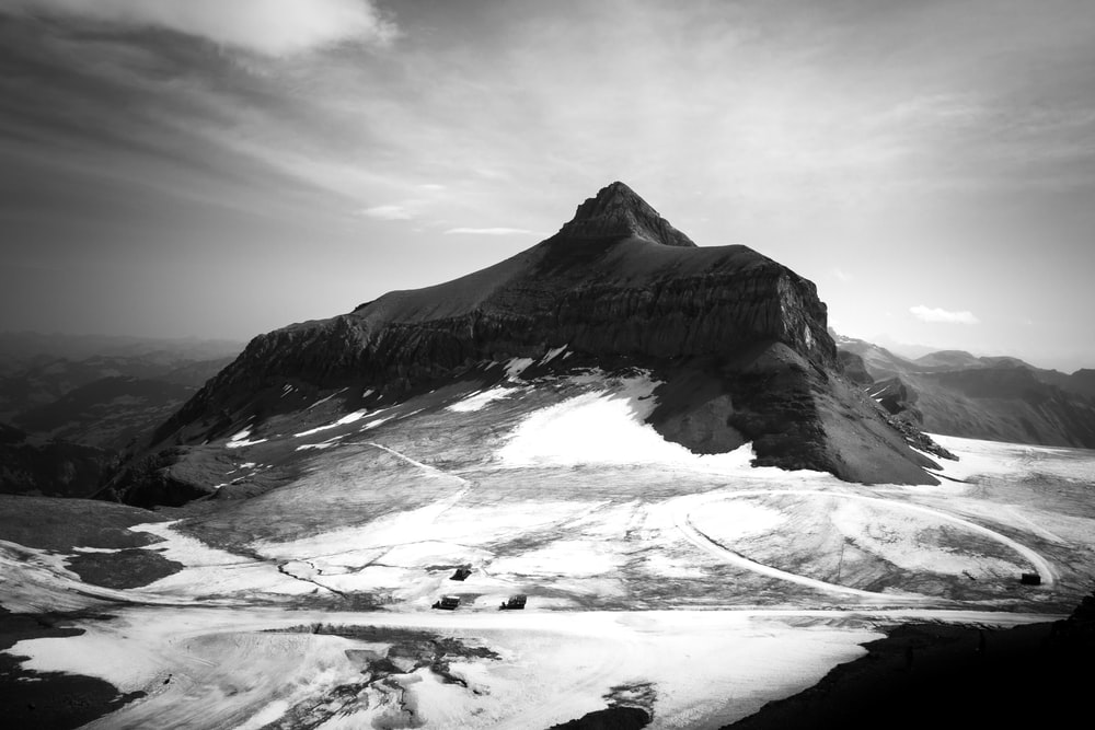 grayscale photo of a snowy mountain
