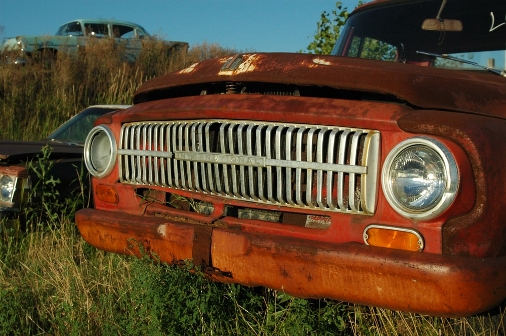 rusted brown pick up truck