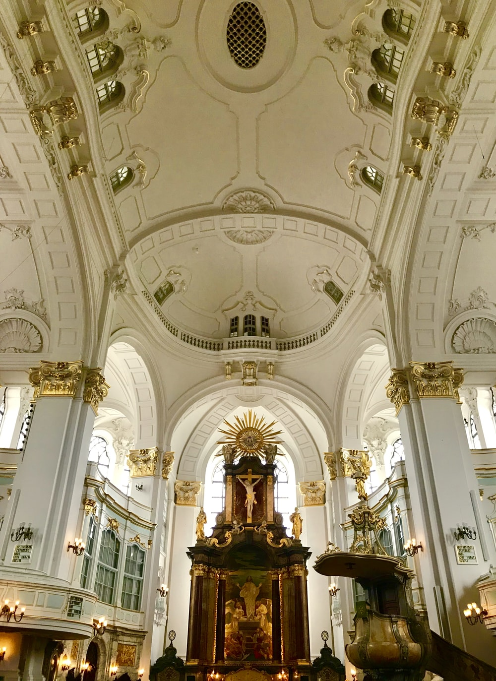 white and gold painted cathedral ceiling