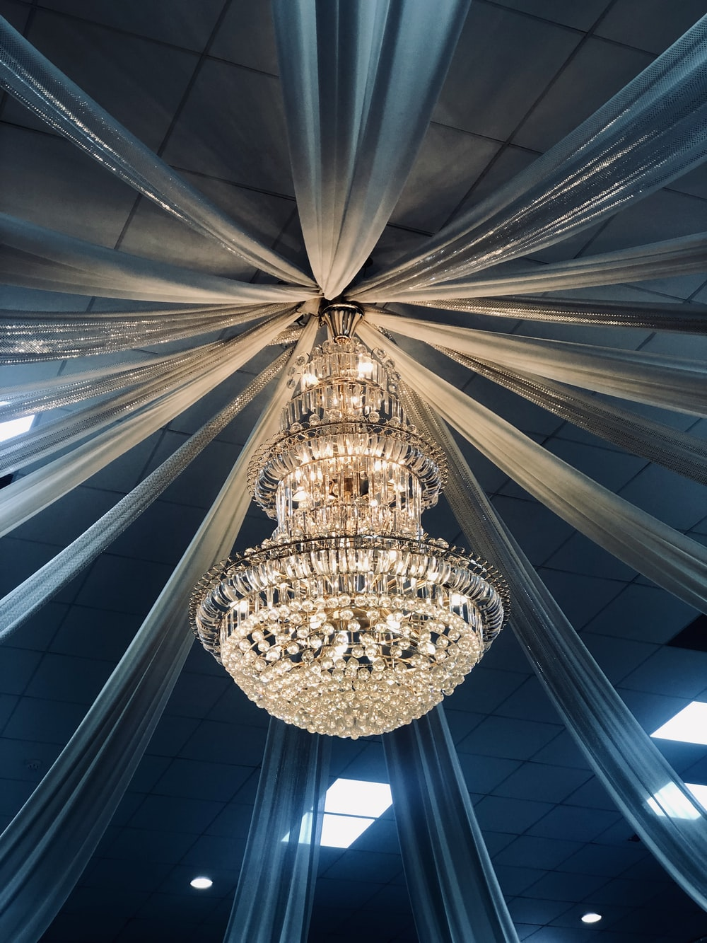 turned-on clear glass chandelier