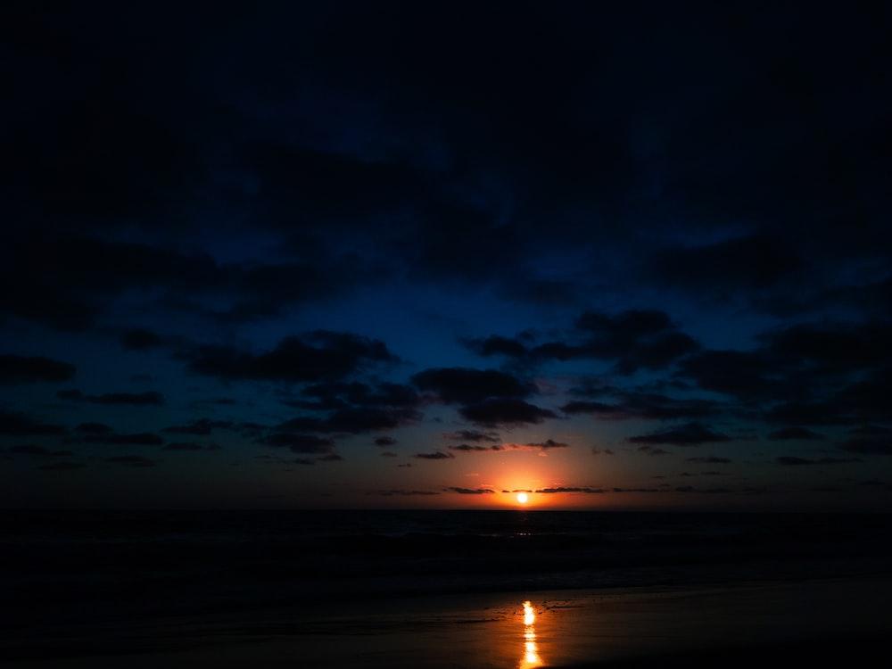 orange setting sun over sea at sunset