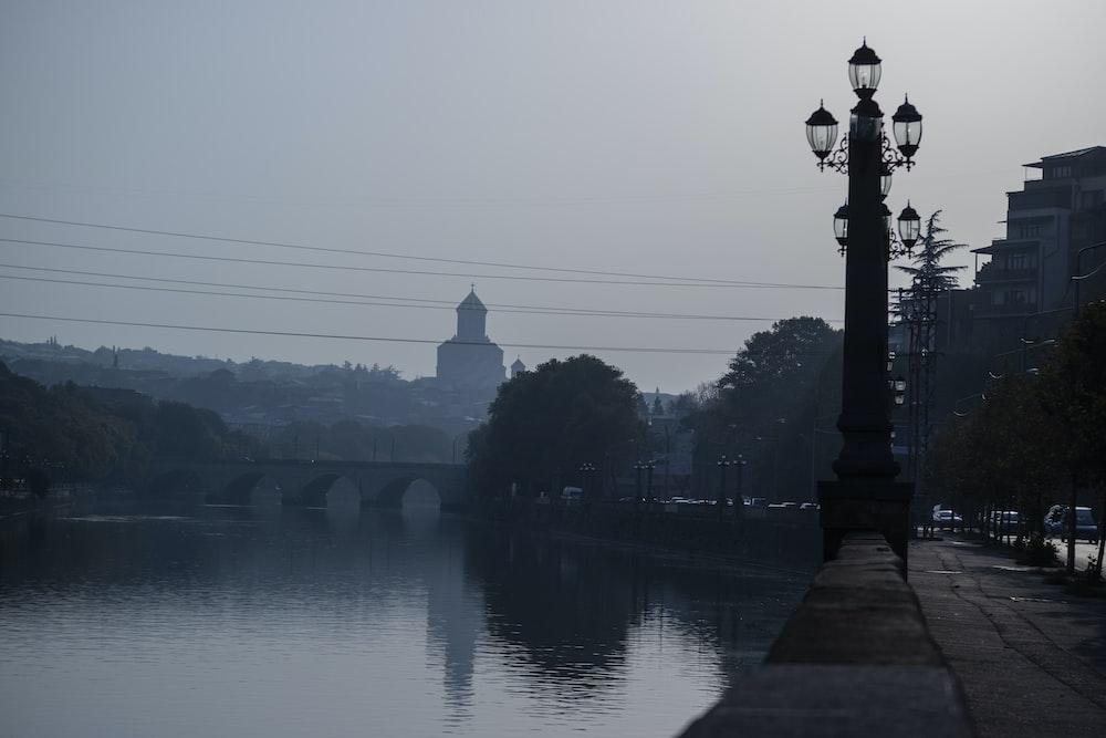 black street light in bank of river