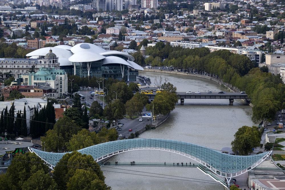 glass roofed steel beam bridge on city river