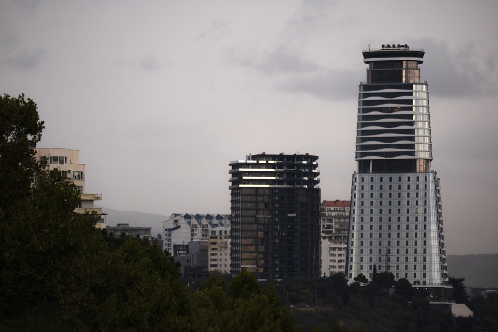 high-rise buildings under grey cloudy sky