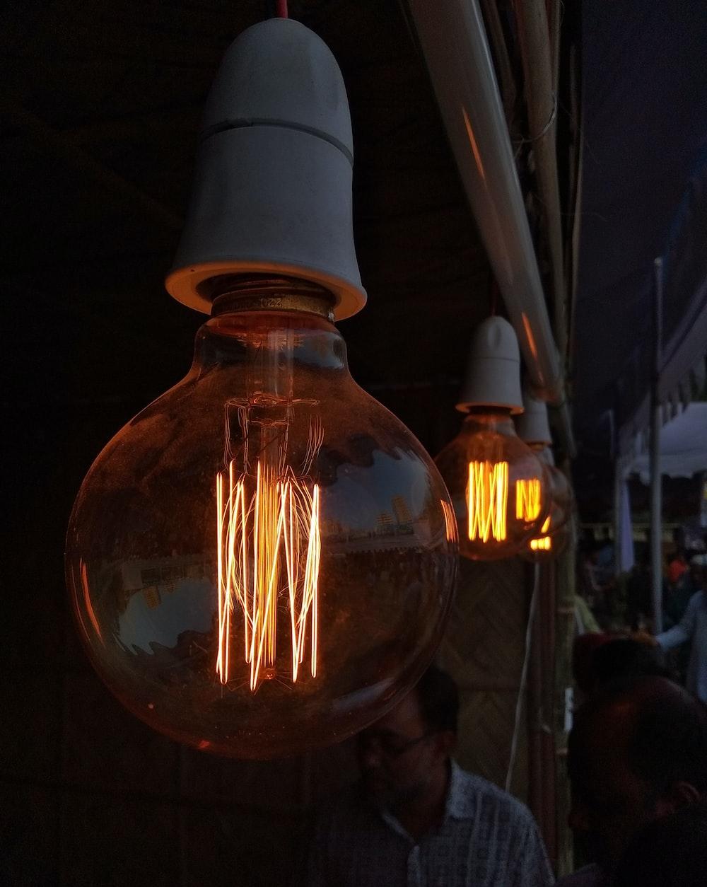 three turned-on filament bulbs