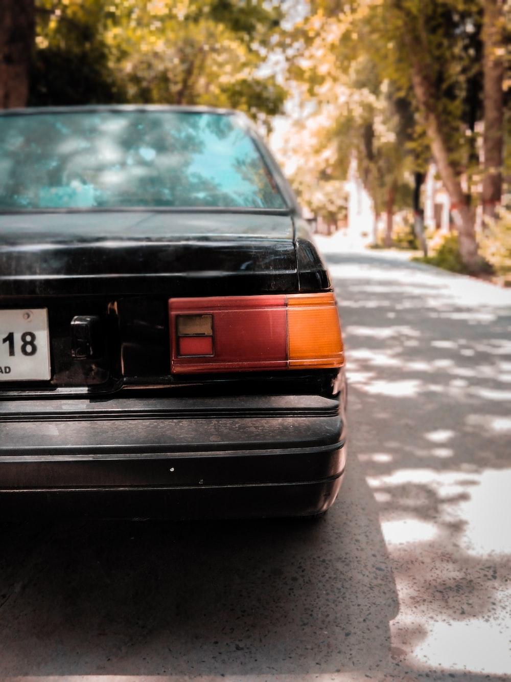 black vehicle on road