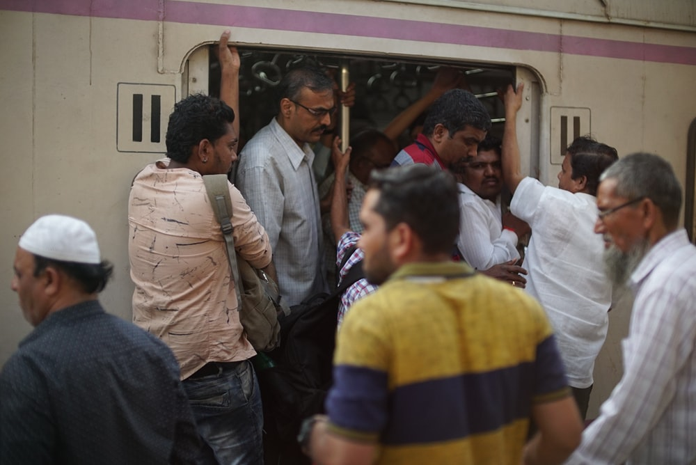 men walking out and in in train