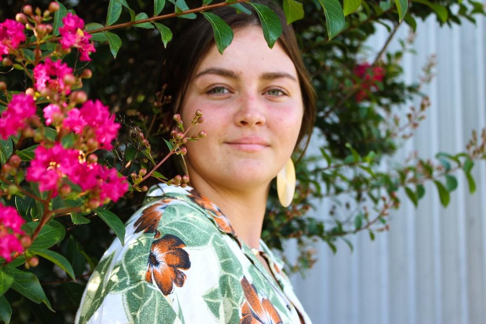 woman wearing boho dress standing near flowers