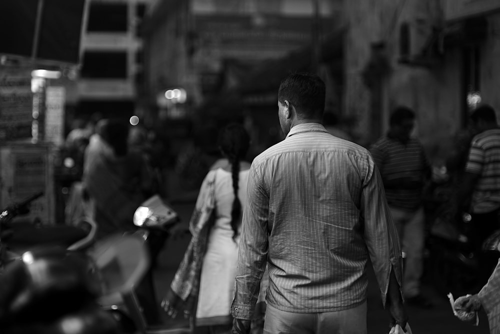 grayscale photography of walking people during daytime